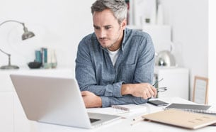 men with computer looking for penile implant